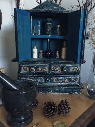 beautifully crafted cabinet to store all the witchery goodies and