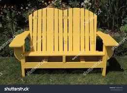 Chair In Garden Yellow Adirondack Two Seater Chair Garden Stock Photo 106881467