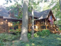 beautiful log home with private beach on cedar lake sleeps 12 pet