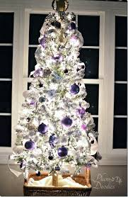 white and silver ornaments on how to decorate a white tree next