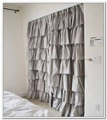 craftiments replacing closet doors with curtains made from
