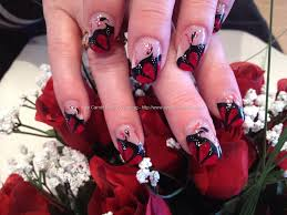red and black freehand nail art over acrylic nails nails