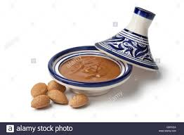 pcea cuisine traditional moroccan almond amlou and almonds on white background