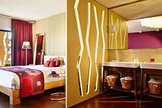 color design hotel your guestroom with seaview orange color scheme bohemia suites