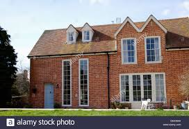traditional brick country house with gable roof and tall windows