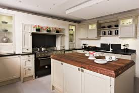 furniture butcher block island with three drawers and shelving modern kitchen design with butcher block island and black countertops also tiles flooring plus recessed lighting