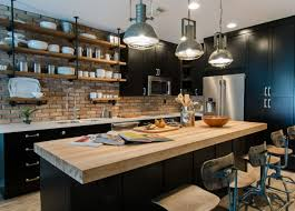 light wood kitchen cabinets with black countertops one color fits most black kitchen cabinets