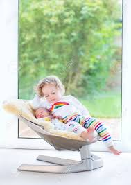 Newborn Baby Swing Chair Newborn Baby Boy And His Toddler Sister Relaxing In A Swing Next