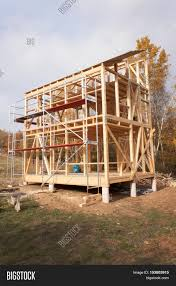 metal scaffolding around the unfinished house construction of