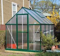 outdoor palram greenhouse with green paint aluminium frame also