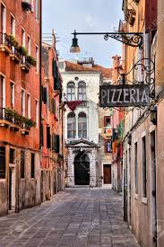 Ancient Italy Map Stock Photos by Quaint Street In Historic Venice Italy With Pizzeria Sign Stock