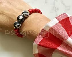 red beaded bracelet lipstick red rice bead university of