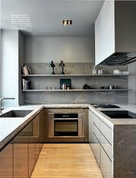 small kitchen dark earthy modern stone countertop waterfall perfect grey tones in this kitchen and look at the edges of the stone countertops unfinished via dustjacket attic
