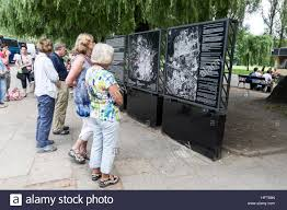 Map Of Concentration Camps Arriving Visitors Reading The Large Information Board And A Map Of