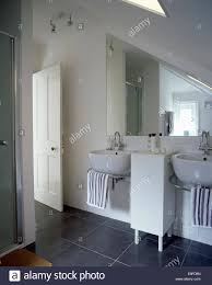 Modern Basins Bathrooms by Double Basins Below Triangular Mirror In Modern White Loft