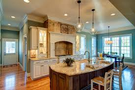 powell kitchen islands granite state glass for a traditional kitchen with a chandelier