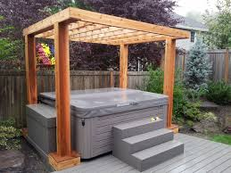 Inexpensive Patio Flooring Options by Composite Deck With Cedar Pergola Done To Spec