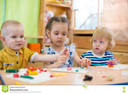 kids group making arts crafts kindergarten interest stock photos