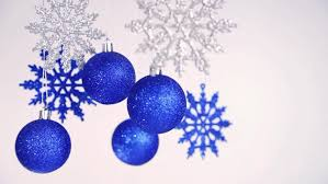 and new year blue balls and snowflakes hanging on silver