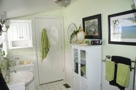 minimalist white bathroom design with simple teak towel rack as