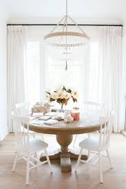 best 25 white dining rooms ideas on pinterest white dining room white dining room with beaded chandelier christmas kitchen table