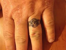 wedding ring finger tattoos with infinity design on finger