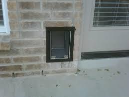 sliding glass door with doggie door dog door in wall