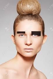 big bun hair fashion woman model with creative make up bun hairstyle with