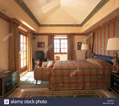 Spanish Bedroom Furniture by Checked Quilt On Bed In Spanish Bedroom With Co Ordinating