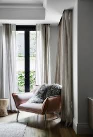 Hanging Curtains From Ceiling To Floor by Keeping It Warm Studio