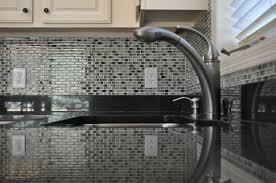 kitchen backsplash grey subway tile rattan chairs white cupboard