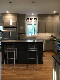 amazing kitchen featuring taupe kitchen cabinets with taupe crown