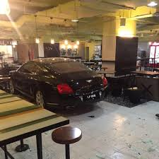 bentley malaysia man accidentally crashes his bentley into food court in bukit