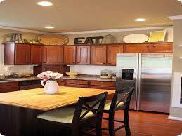 Above Kitchen Cabinet Decorations How To Decorate Above Kitchen Cabinets On A Budget Design Idea