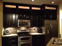 rock kitchen backsplash espresso cabinets light granite stacked rock backsplash with in