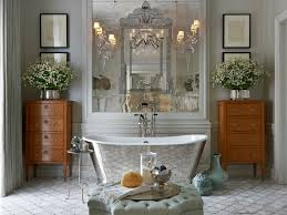 bathroom silver tub tufted ottoman arabesque tile chandelier