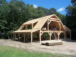 cordwood frame with gambrel roof like the structure design of