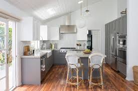 los angeles over kitchen sink farmhouse with mixed cabinet colors