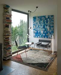 eco friendly house reading corner with floor to ceiling glass