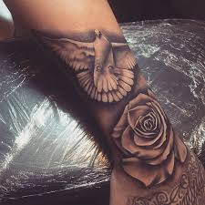 realistic rose and dove tattoo on arm sleeve