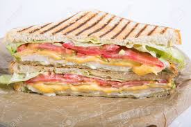bacon wrapping paper grilled chicken sandwich on a wrapping paper stock photo picture
