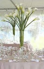 Vase Table Centerpiece Ideas Calla Lilies Centerpiece With White Ribbon Around The Vase How