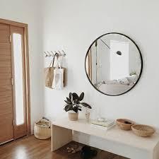 spiegel fã r flur flur einrichten deko flur runder spiegel weiser tisch pflanzen