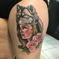 black simple heartbeat tattoo on thigh
