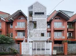 rowhou com landmak architecture wraps a row house in vietnam with a lace like
