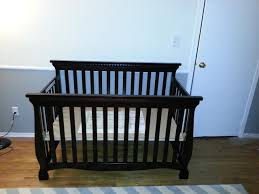 Cribs That Convert Into Toddler Beds by Bad Renovations Nursery