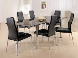 kitchen glass kitchen table and 3 oval back dining chairs and