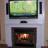 Corner Gas Fireplace With Tv Above by Furniture Corner Wall Mount Tv Stand Over Fireplace Added Black