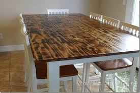 burn on wood diy dining table with burned wood finish using a bernzomatic