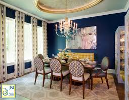 dramatic dining room with navy walls and gold plastered dome